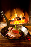 Steak in Pan with Chimney Fire Royalty Free Stock Image