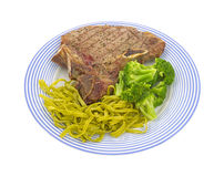 Steak with pasta and broccoli Stock Photos