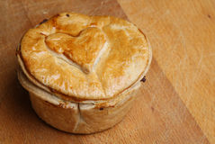 Steak Pie. Individual steak pie with heart shape on crust Royalty Free Stock Photos