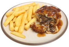 Steak Pie with Chips. And gravy Stock Photo