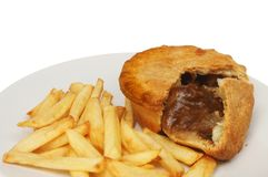 Steak pie and chips. Closeup of steak pie and chips royalty free stock photo