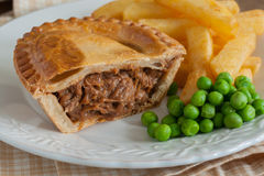 Steak Pie Chips and Peas Stock Image