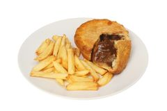 Steak pie and chips. On a plate isolated against white royalty free stock photo