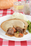 Steak pie with gravy and vegetables Stock Images