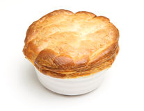 Steak Pie Isolated. Individual steak pie, fresh out of the oven Royalty Free Stock Photo