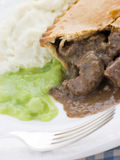 Steak Pie and Mash with Mushy Peas Stock Image