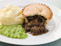 Steak Pie and Mash with Mushy Peas Royalty Free Stock Photography