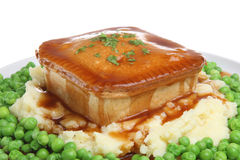 Steak Pie, Mash, Peas and Gravy. Steal pie with mashed potato, peas and gravy Royalty Free Stock Images
