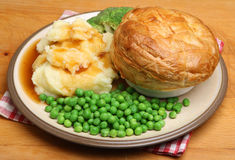 Steak Pie with Mash and Peas. Steak pie with mashed potato, vegetables and gravy Stock Images