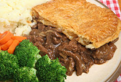 Steak Pie with Mash and Vegetables Stock Photo