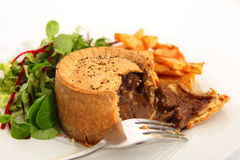Steak pie salad and fries Stock Image