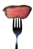 Steak. Piece of a grilled steak on a fork Royalty Free Stock Image