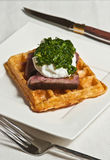 Steak, poached egg and waffle with chimichurri Royalty Free Stock Photos