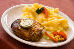 Steak of pork,grilled-with salad of potatoes Stock Photos