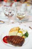 Steak with potato au gratin and vegetables Royalty Free Stock Images