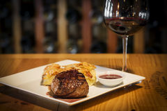 Steak with potato and cheese bake and red wine Royalty Free Stock Photography