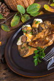 Steak with potato dumplings and forest mushroom sauce Royalty Free Stock Images