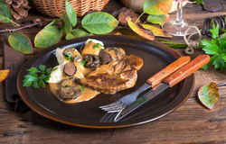 Steak with potato dumplings and forest mushroom sauce Stock Photo