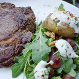 Steak and potato. Steak, potato and fresh salad Stock Image