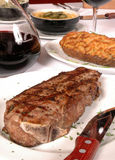 Steak and potato with knife Stock Image