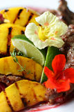 Steak with potato and pink onion Stock Image