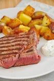 Steak with potato wedges royalty free stock photo