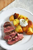 Steak with potato wedges Stock Photo