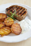Steak with potato wedges Stock Images
