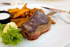 Steak with Potato Wedges ,salad. Grilled Steak with Potato Wedges ,salad royalty free stock photography