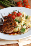Steak with potatoes Stock Image