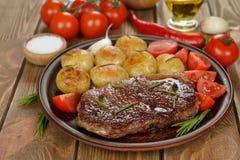 Steak with potatoes Stock Photos