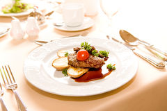 Steak with potatoes. On the dish Royalty Free Stock Images