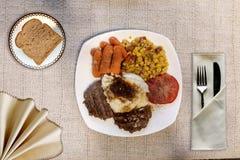Steak, potatoes and gravy stock photos