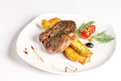Steak with potatoes and sause Stock Photography