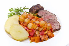 Steak, potatoes and vegetables Stock Image