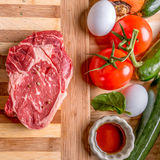 Steak and produce with eggs Royalty Free Stock Photos