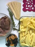 Steak with prunes and dried apricots under cheese. For baking in the oven with potatoes. Added spices and rosemary. Steak with prunes and dried apricots under stock photo
