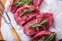 Steak. Raw beef steak. Fresh raw Sirloin beef steak sliced o Herb - Rosemary decoration Stock Photo