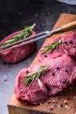 Steak. Raw beef steak. Fresh raw Sirloin beef steak sliced o Herb - Rosemary decoration Stock Photography