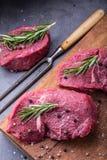 Steak. Raw beef steak. Fresh raw Sirloin beef steak sliced o Herb - Rosemary decoration Stock Photos