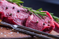 Steak. Raw beef steak. Fresh raw Sirloin beef steak sliced o Herb - Rosemary decoration Royalty Free Stock Images