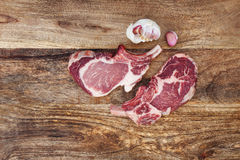 Steak raw with garlic to grill Stock Images