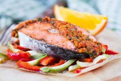 Steak red fish salmon on vegetables, zucchini and paprika Royalty Free Stock Photography