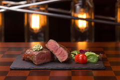 Steak rib-eye. Garnished with grilled vegetables on stone plate Royalty Free Stock Photos