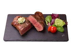 Steak rib-eye. Garnished with grilled vegetables  on white background Stock Image