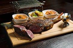 Steak rib-eye garnisheda with vegetables Stock Photos