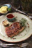 Steak ribay with mashed potatoes and sauce. Royalty Free Stock Image