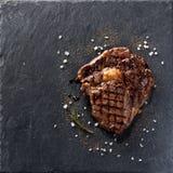 Steak Ribeye. Beef steak Ribeye on black stone background Stock Image