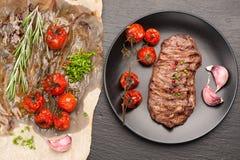Steak Ribeye entrecote and baked tomatoes Royalty Free Stock Photos