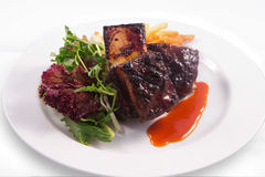 Steak ribs, vegetables salad and french fries. On white background Stock Photos